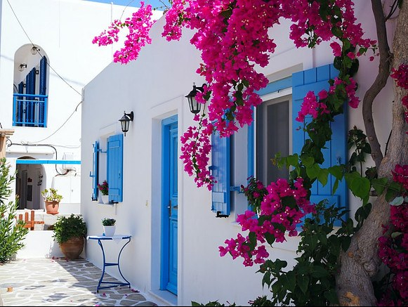 moving-to-Crete-How-to-find-a-job-blue-and-white-house-and-pink-flowers